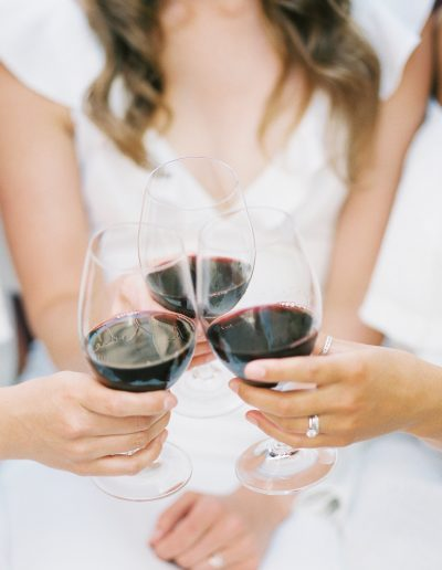 Guests enjoying wine by Amber Glanville Photography